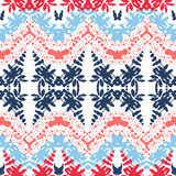 Zigzag - seamless geometric pattern. Blue, pink and red color. On a white background Stock Photos