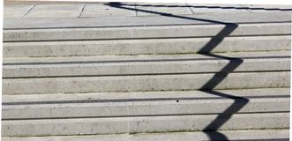 Zigzag shadow on concrete steps Stock Images