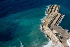 Zigzag shaped pier view from above at Calpe, Spain. Zigzag shaped pier view from Natural Park of Penyal d`Ifac, Calpe, Spain royalty free stock photos