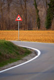Zigzag sign on road bend. Zigzag sign on curved bend of country road stock images