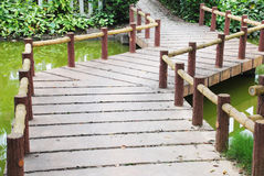 Zigzag stone garden bridge Royalty Free Stock Photography