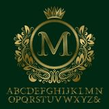 Zigzag striped gold letters and initial monogram in coat of arms form with crown. Elegant font and elements kit for logo. Design stock illustration