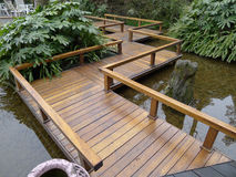 Zigzag style wooden footbridge. In the park royalty free stock photo