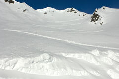 Zigzag traces of ski mountaineers. On a snow-covered mountain slope, skiing area Chamonix, Haute-Savoie, France Stock Photos