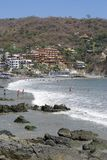 Zihuatanejo Beach. The view of a stony beach in Mexican resort town Zihuatanejo Stock Photo