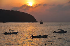 Zihuatanejo Boats At Sunset. This image is of fishing boats moored  in Zihuatanejo Bay  at sunset Royalty Free Stock Image