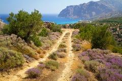Zij weg bij het overzees op Kreta Stock Foto