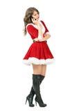 Zijaanzicht van het ernstige Santa Claus-vrouw spreken op de telefoon die neer eruit ziet Royalty-vrije Stock Afbeeldingen