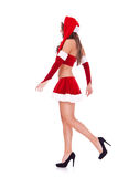 Zijaanzicht van het sexy santa lopen Royalty-vrije Stock Afbeeldingen