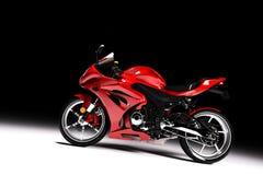 Zijaanzicht van rode sportenmotorfiets in een schijnwerper Stock Afbeeldingen