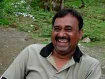 Zijn spontane glimlach Stock Foto's