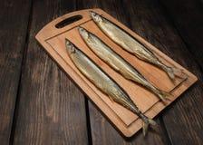 Zijn verse gerookte vissen Stock Foto