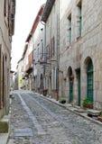 Zijstraat in Lagrasse Frankrijk Stock Foto's