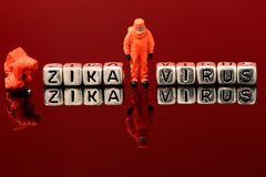 Zika Virus on beads with miniature scale model chemical team Stock Photos