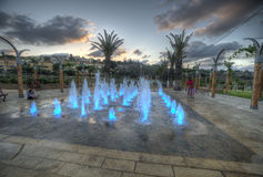Zikhron Ya'akov, Israel, September 23, 2014 : kids playing in colored fountain at the playground Stock Images