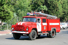 ZIL 130. SOCHI, RUSSIA - JULY 24, 2009: Red ZIL 130 firetruck at the city street Stock Photos