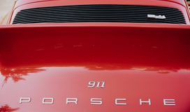 A close up image of the red vintage Porsche 911 coupe logo. Zilina, - Slovak Republic, August 4, 2018: A close up image of the red vintage Porsche 911 coupe logo royalty free stock photo