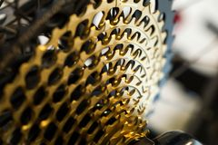 12 speed bicycle MTB chain casette - gold. Slovakia. Zilina, Slovakia; 10-Jun-2018. 12 speed bicycle MTB chain casette - gold. Slovakia stock image