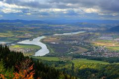 Zilina town in autumn from Mala Fatra mountain. View of the evening city from the mountains in Slovakia, dark grey storm clouds. M Stock Images
