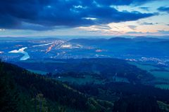 Zilina town in the naght from Mala Fatra mountain. Factory with light. View of the evenig city from the mountains in Slovakia. Mou. Zilina town in the naght from Royalty Free Stock Images