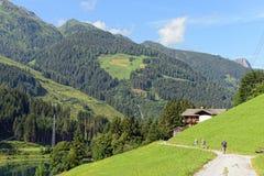 Zillertal valley landscape in Tirol. hikers walking along Aust Stock Image