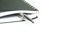 Zilverachtig pen en notitieboekje Royalty-vrije Stock Afbeelding