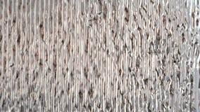 Zilverachtige glanzende muurdeklaag, het materiaal van de hitteisolatie blur stock footage