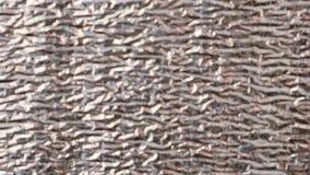 Zilverachtige glanzende muurdeklaag, het materiaal van de hitteisolatie blur stock video