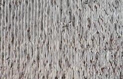 Zilverachtige glanzende muurdeklaag, het materiaal van de hitteisolatie Verticale lijnen royalty-vrije stock foto