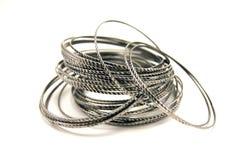 Zilveren armbanden Stock Foto's