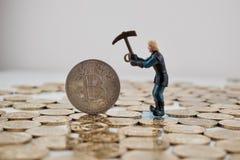 Zilveren bitcoinmijnbouw stock foto's