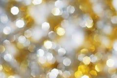 Zilveren en gouden lichtenachtergrond stock foto's