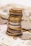 Zilveren en gouden muntstukken Stock Foto