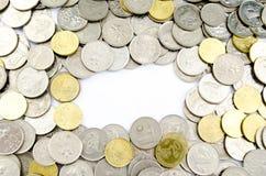 Zilveren en gouden muntstukken Royalty-vrije Stock Afbeeldingen