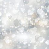 Zilveren hartenachtergrond Stock Foto's