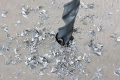 Zilveren het staalplaat van Sctratchy met boor in het werk Stock Foto's