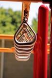 Zilveren Lijn van Driehoek Gestalte gegeven Ringen op Gele Bar Royalty-vrije Stock Fotografie