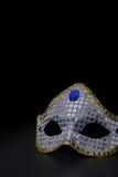 Zilveren masker op zwarte Royalty-vrije Stock Afbeeldingen
