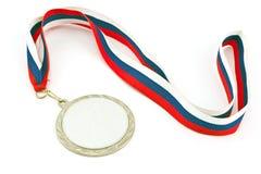 Zilveren medaille met kleurenstrepen stock foto's