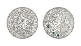 Zilveren muntstuk Astrologisch teken Steenbok stock afbeeldingen