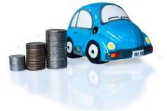 Zilveren muntstuk en autospaarvarken Stock Afbeelding