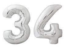 Zilveren nummer 34 vierendertig gemaakt van opblaasbare die ballon op wit wordt geïsoleerd Stock Foto's