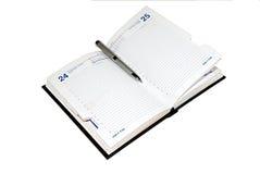 Zilveren pen en open agenda. Stock Afbeeldingen