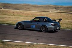 Zilveren Raceauto op Spoor Stock Foto's