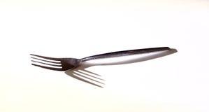 Zilveren vork met schaduw stock afbeelding
