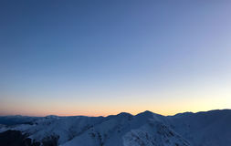 Zim gór Śnieżny zmierzch Fotografia Stock