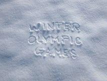 Zim olimpiady - Pisać W śniegu zdjęcia stock