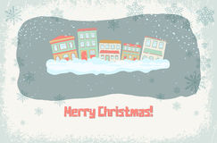 Zima budynki z opadem śniegu i dekoracyjnymi płatkami śniegu Obrazy Royalty Free