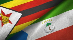 Zimbabwe and Equatorial Guinea two flags textile cloth, fabric texture. Zimbabwe and Equatorial Guinea two folded flags together royalty free illustration