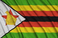 Zimbabwe flag is depicted on a sports cloth fabric with many folds. Sport team banner. Zimbabwe flag is depicted on a sports cloth fabric with many folds. Sport stock photography